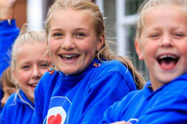 young girls cheering as part of the RAF Airplay fund