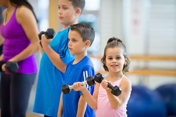 Children taking part in family exercise session