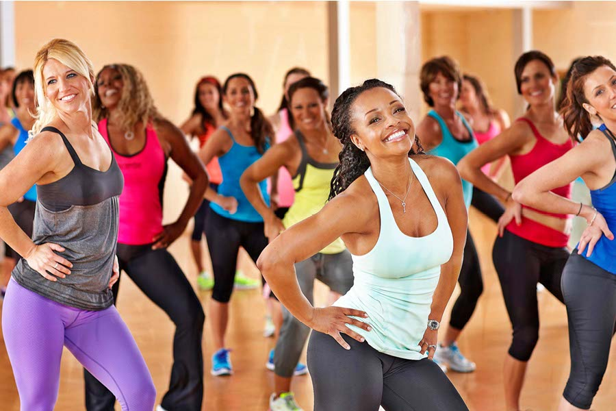 Group of ladies enjoying a zumba fitness class at YMCA Ygym