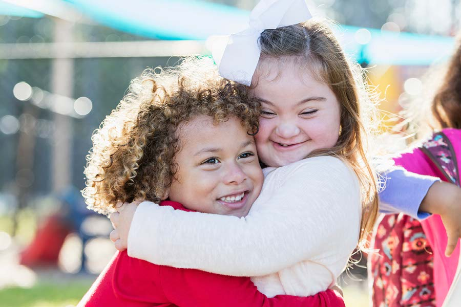 two children hugging eachother at ymca day care